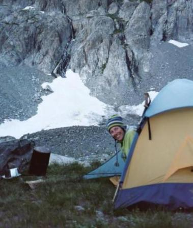 Mary Jo in her tent below the SE Glacier of Mt. Ritter.